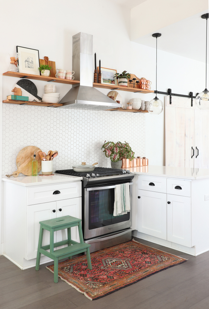 SHOP THE KITCHEN: Rejuvenation Copper Carson 12u2033 Wall Sconce · The Tile Shop  2u2033 Matte White Hexagon Tiles · Kohler Matte Black Purist Faucet