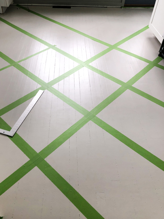 more tape down in preparation for the patterned painted wood floors