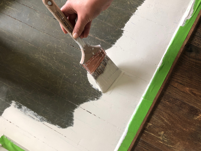 the first brushes of paint on the wood floor