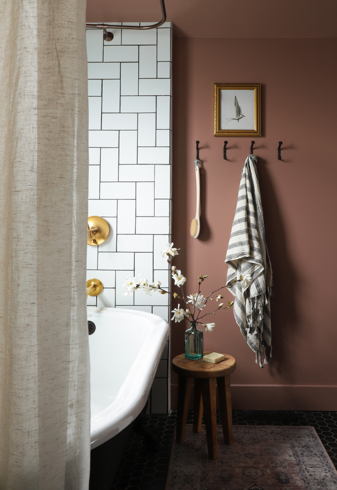 a subway-tiled bath with mauve-colored walls from I Spy DIY