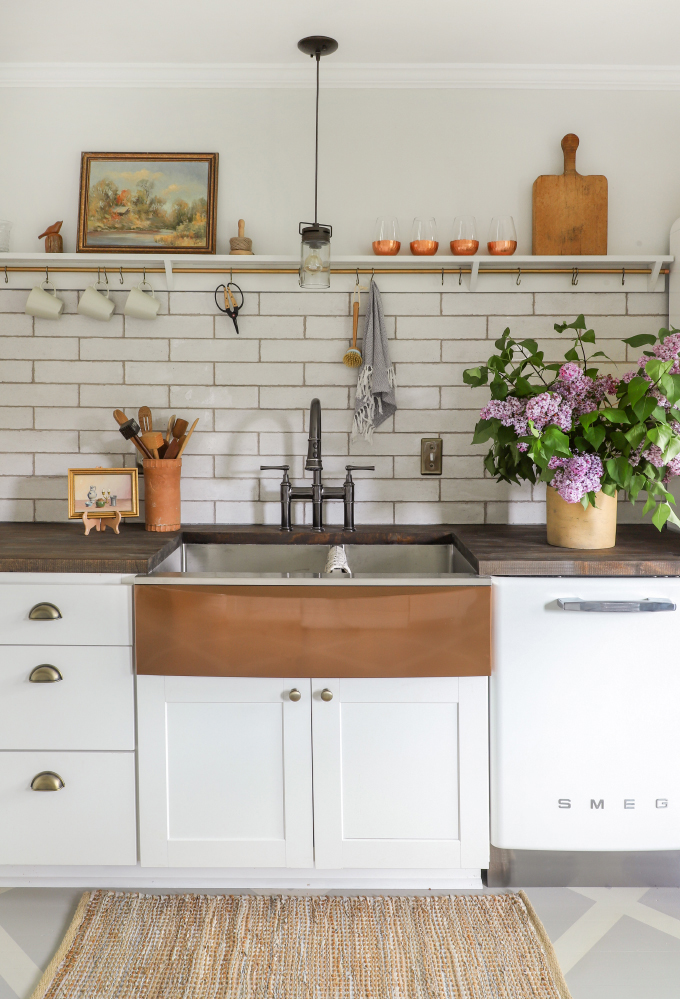 farmhouse kitchen sink with subway tile and open shelving from I Spy DIY
