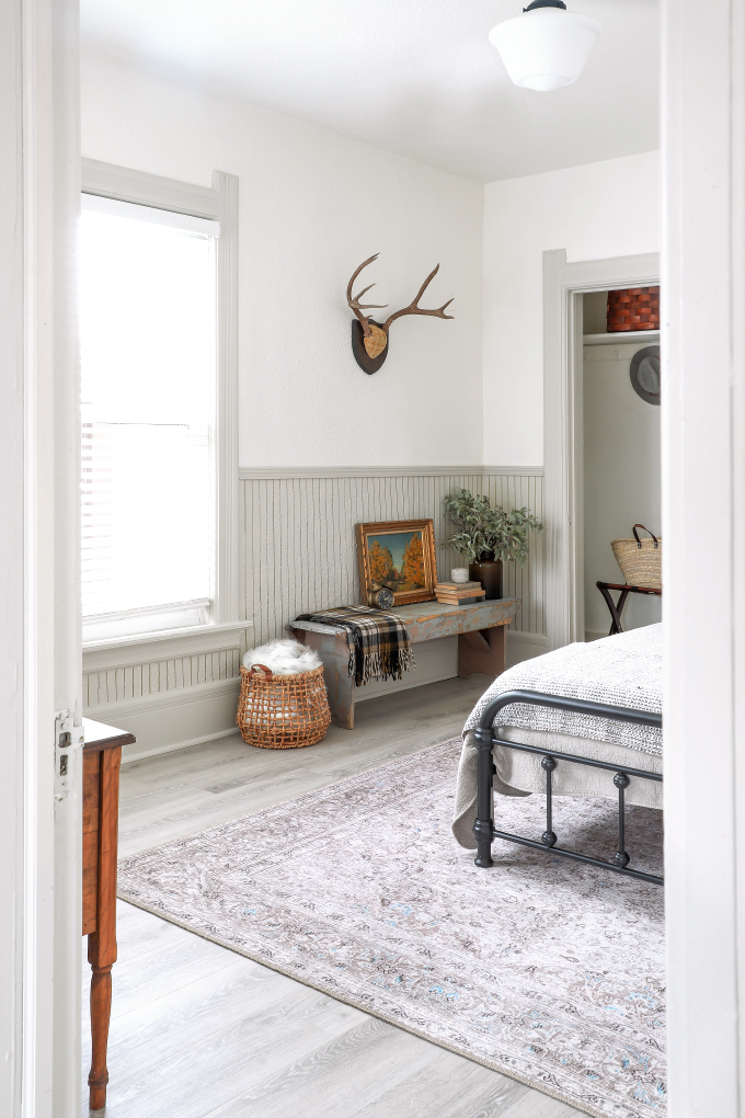 a grey farmhouse-styled room featuring antlers on the wall from I Spy DIY