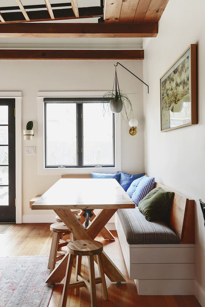 breakfast nook with bench and stools at an Instagram worthy Airbnb