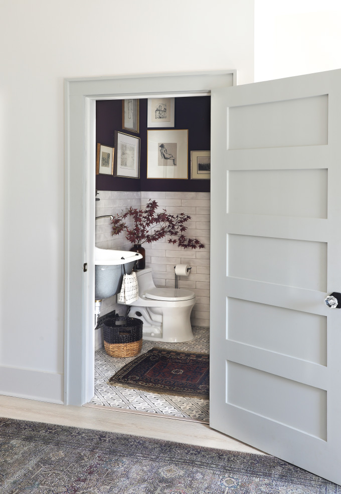 view into the doorway of an eggplant bathroom from I Spy DIY